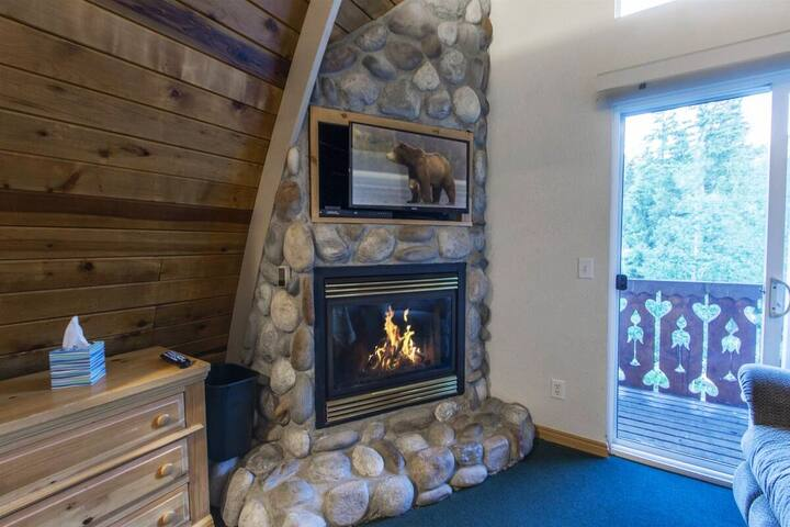 Master bedroom fireplace, TV, jetted tub, private deck and private door to upstairs bathroom.