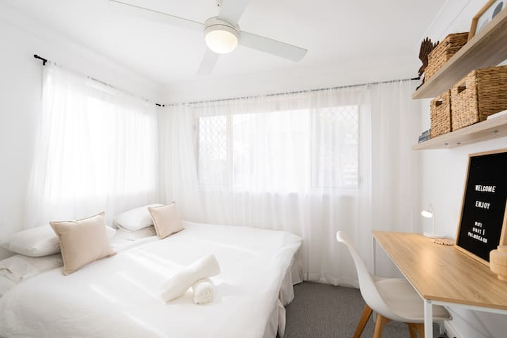 The 3rd bedroom has two pull apart single beds (perfect for kids!) and a workspace area.