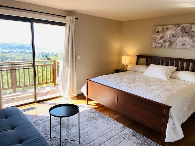 Master Suite with King bed...enjoy the views from the room or walk onto the wrap around deck
