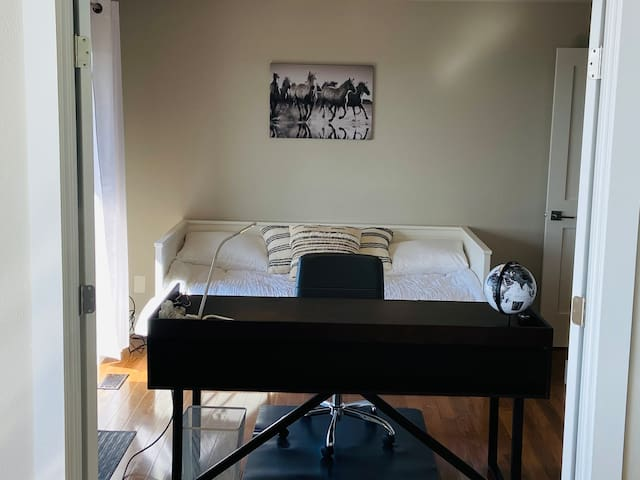 Additional Guest Bedroom with option for two beds. Large desk which can be used for work.
