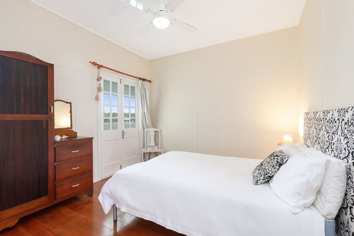The second bedroom is replete with a plush double bed, wardrobe with vanity and access to the over-sized deck.