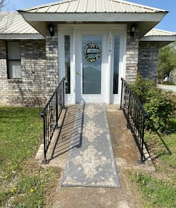 Front door has a wheel chair ramp and the back door is on ground level. No stairs inside home.