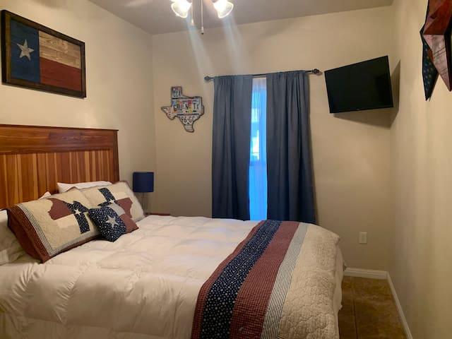 Queen Bed and Smart TV