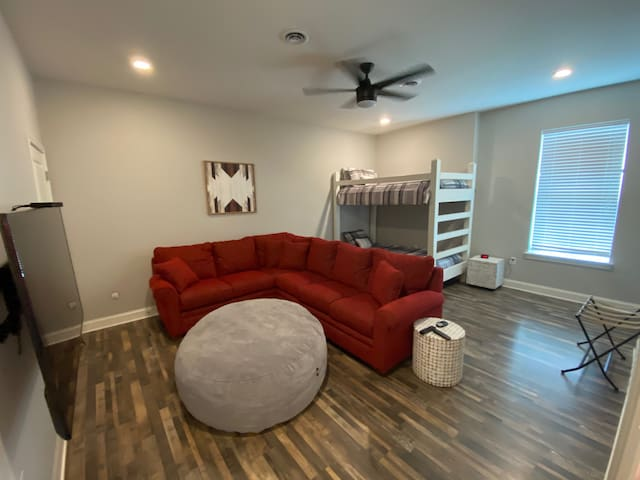 Large kid room/2nd living room with 2 twin bunk beds.
