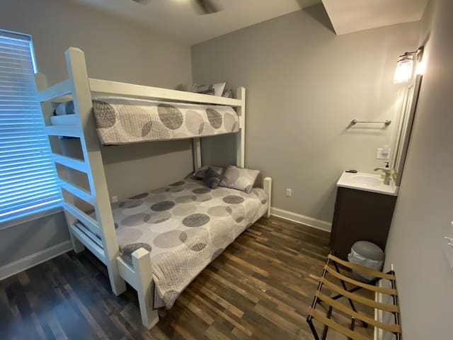 Bedroom off of kid room with full/queen bottom and twin top.