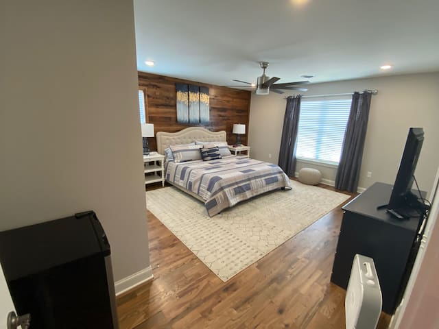 Kind bedroom on second level with ensuite bath and small refrigerator.