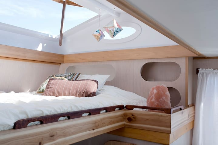 Nomad's Sleeping Loft - double bed under pop-up hatches