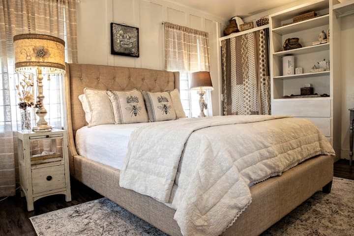 The master bedroom is bee-utifully decorated with top quality linens and bedding, room darkening shades, writing desk perfect for pulling out your laptop, luggage racks, air purifier/humidifier, lots of closet, hangers and drawer space for clothing.