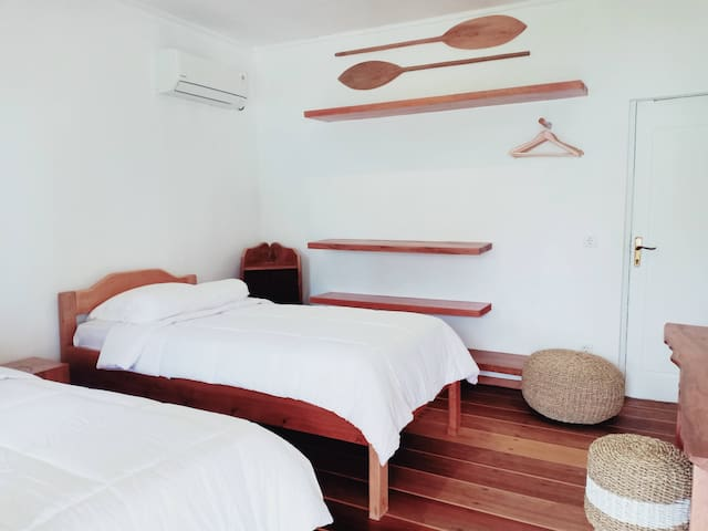 Twin room bungalow with two wide single beds, working desk, clothes hangers and shelves, private bathroom, air con and ocean view.