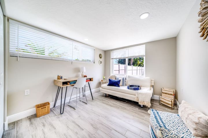 """3rd bedroom can double as an office.  This modular room has been outfitted with a queen sized convertable bed, a desk and  comfy floor """"poof"""".  Plenty of closet space and large windows that overlook the private yard."""