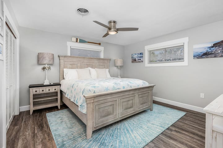 Unit #2 (2-bed) King size bed, large wall mounted TV and closet space for your clothes.