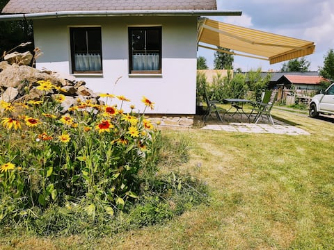 Cabin in a flower garden