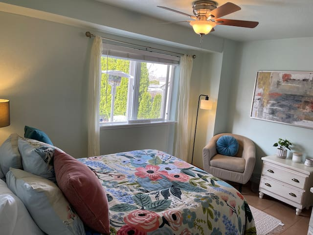 Your private ground floor suite bedroom includes a queen bed with a down duvet, a comfy chair, and for storage, plenty of drawers and a closet for hanging clothes.