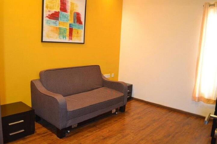3rd Bedroom - Air Conditioner, Sofa set, wardrobe and 2 floor mattress