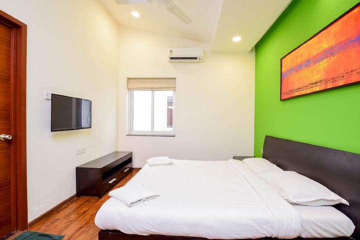 2nd Bedroom - Air Conditioner, King size bed, bed side drawers, wardrobe and attached bathroom