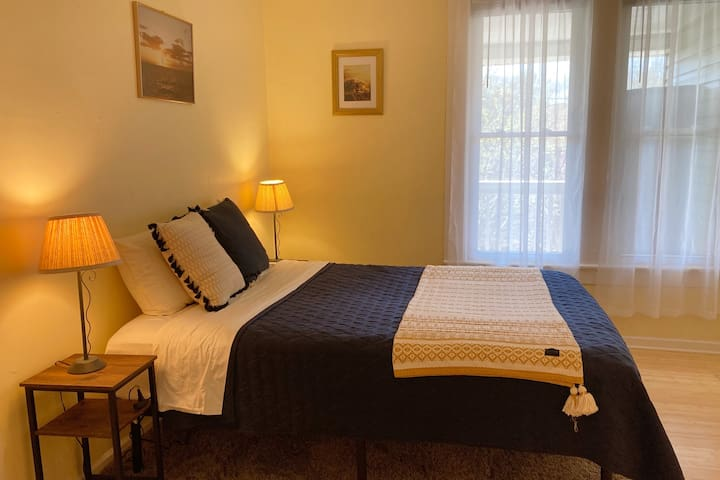 Your bedroom: sunny during the day, and has nice warm lighting in the evenings. The room has a ceiling fan, closet, bench and each bedside table has a plug strip.
