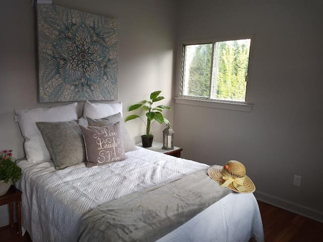 Bedroom with wooded view.