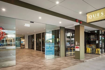 Walk into entry foyer off street level, into lift, tap key card & select level 9
