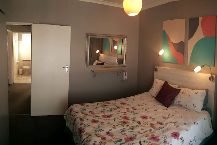 The second bedroom with queen size bed and has a sliding door that opens on the balcony.