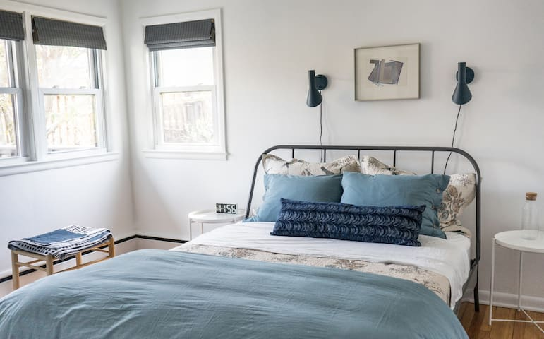 """The master bedroom or """"blue room"""" is spacious and bright."""