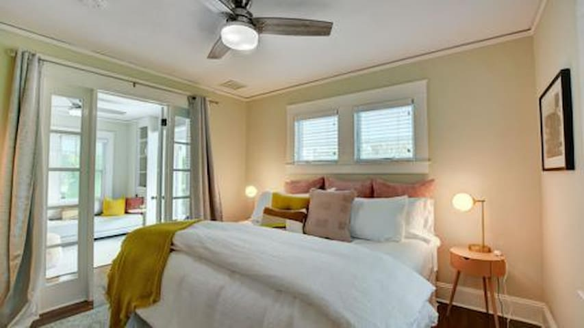 French doors with privacy curtains adjacent to extra bedroom/office