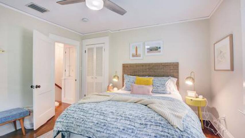 Queen bedroom with bedside tables, lamps & charging hub. Closet.