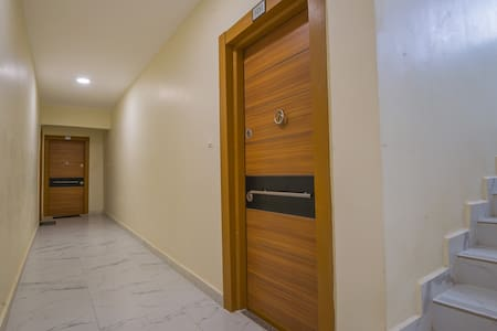 The pathway is at least more than 32inches wide with no slope or elevation from the floor for easy access to the apartment