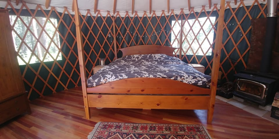 the King-sized bed with a view of the lake is perfect for romantic getaways