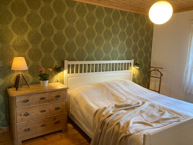 Bedroom with a double bed (main house)