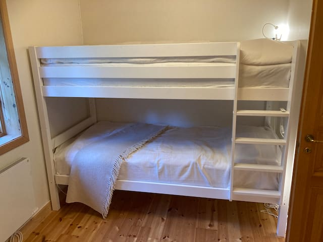 Bedroom with a bunk bed (main house)
