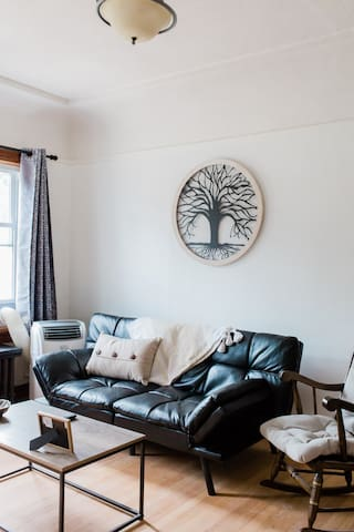 Family room (Backhouse). You not only get a 1000sqft living entertainment space, but you get a small intimate family room with 55in tv, small leather fold up/down sofabed, cushioned rocking chair,  & coffee table. Great for a small group to chill