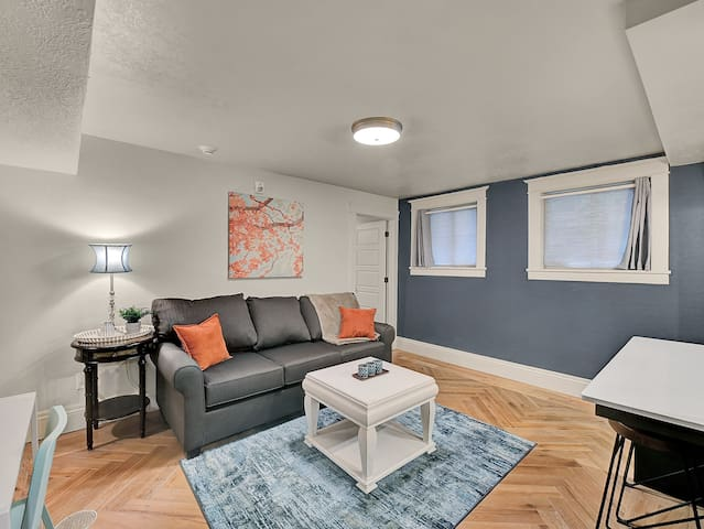 Great Space!  Blue and Orange color inspired decor and style in a very Spacious Living Room.