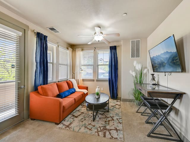"""Greek inspired décor and style in a very Spacious Living Room.  There is a 50"""" Roku TV,  Desk for a work station and a sofa sleeper with black out curtains for that extra guest."""