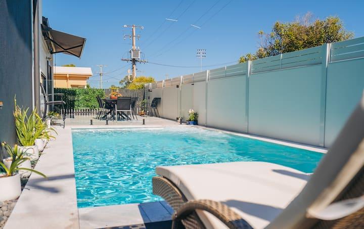 Check it out! Stunning luxury pool retreat w/ wine