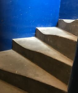 Staircase to flat, in the turret.