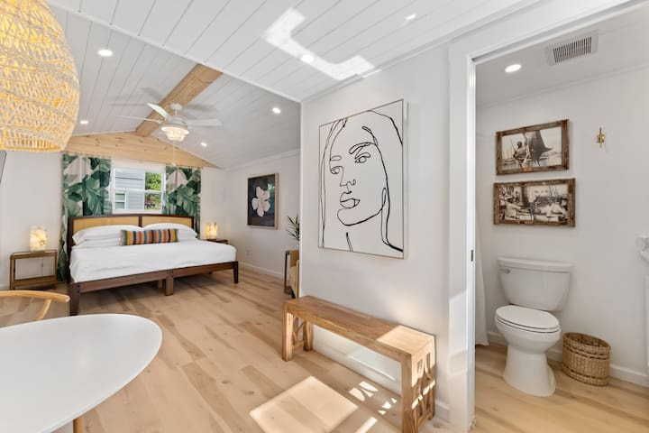 Enjoy this oasis one block from the ocean. Key West inspired interiors with high ceilings and incredible natural light.