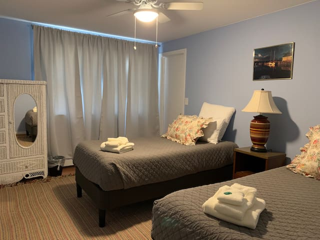 Twin Room with two adult sized twin beds. These can easily be converted into a King with our very comfortable mattress topper.  Let us know what works better for your group!