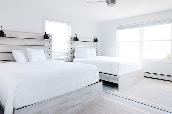 """bedroom 1 on second floor: 2 queens, walk in closet, 70"""" HDTV"""
