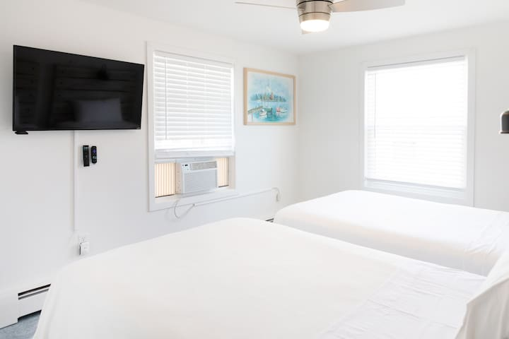 """bedroom 2 on second floor: 2 full sized beds, large closet, 42"""" HDTV"""