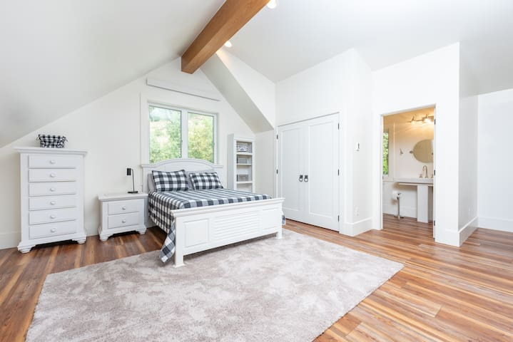 Sleeping loft with full bed, twin bed and bathroom.