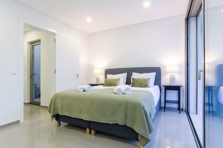 Bedroom 1 with spacious private terrace and ensuite bathroom