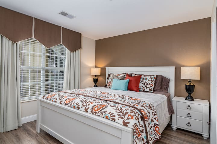 The second bedroom features a king bed and a door directly into the hall bath.