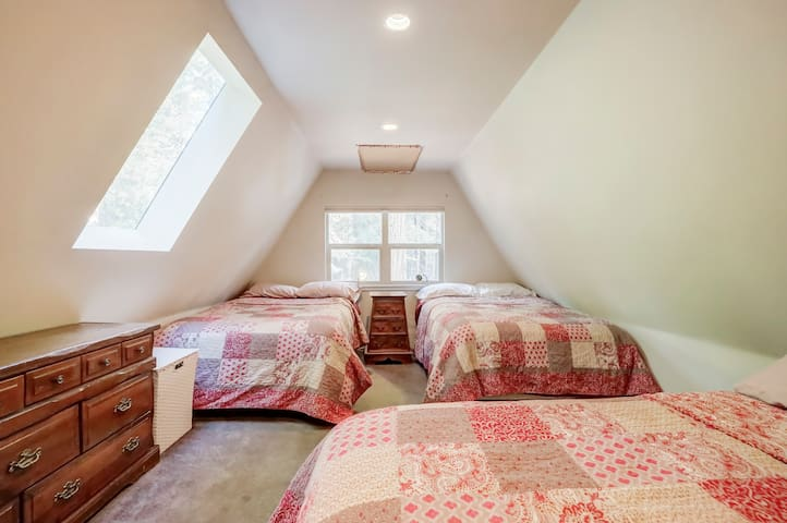 upstairs bedroom to the right of the stairs - two full beds and one queen.   no door to room or closet - it is open to the small hallway at the top of the stairs