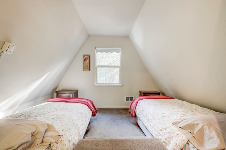 referred to as the drop down room - two twin bed on either side of the stairs that step down into the room off the common room upstairs