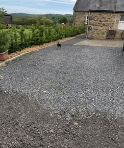 the path from car park is part gravel and part tarmac and its flat to the door enterence