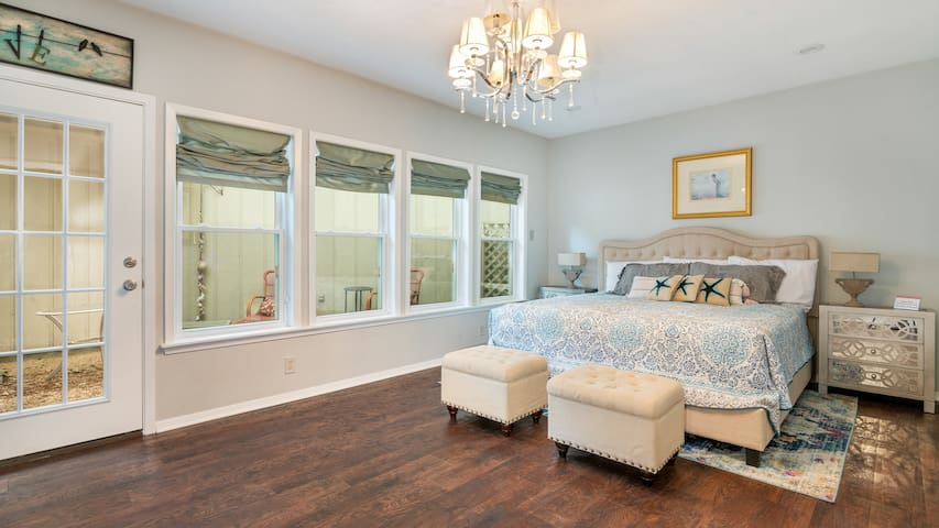 The Master bedroom boasts a luxury king size bed with adjoining private porch!