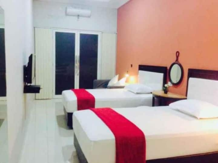 Clean Deluxe Twin at Cozy Room at Apartemen Uttara