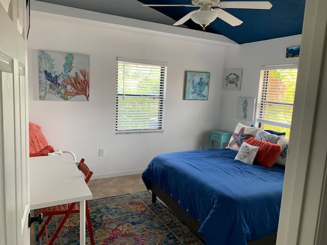 """""""Blue room"""" with queen bed, TV w/firestick, fan, closet, and workspace."""