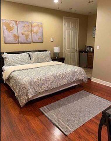 Master bedroom with en suite full bathroom and kitchenette