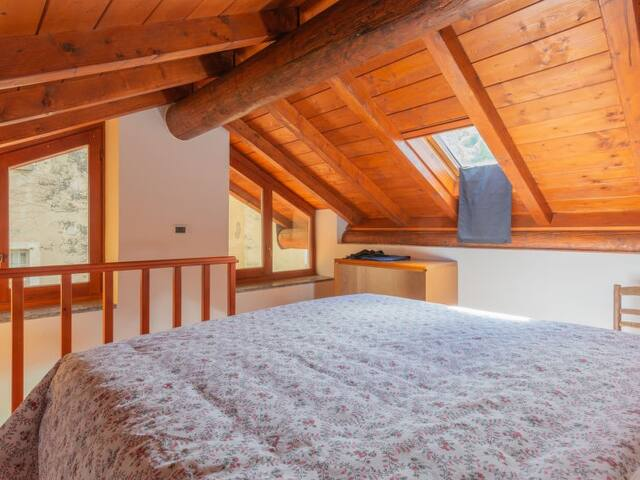 room with double bed ( be careful the height in the center is less than 190 cm )